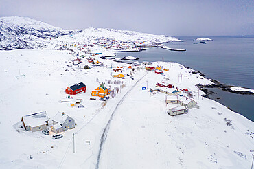 Fishing village of Breivikbotn covered with snow, Soroya Island, Hasvik municipality, Troms og Finnmark, Northern Norway, Scandinavia, Europe