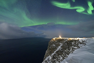Northern Lights (Aurora Borealis) over North Cape cliff in winter, Mageroya island, Barents Sea, Troms og Finnmark, Northern Norway, Scandinavia, Europe