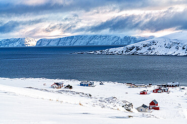 Fishing village of Honningsvag covered with snow surrounded by the icy sea, Nordkapp, Troms og Finnmark, Northern Norway, Scandinavia, Europe