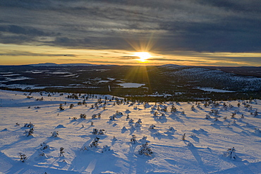 Arctic sunset over the snowy forest and ski area of Levi, Sirkka, Kittila municipality, Lapland, Finland, Europe