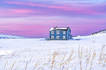 Isolated house in the snow under the pink arctic sunset, Veines, Kongsfjord, Varanger Peninsula, Troms og Finnmark, Norway, Scandinavia, Europe