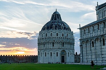 Woman admiring the majestic Pisa Cathedral (Duomo) and Baptistery at sunset, Piazza dei Miracoli, UNESCO World Heritage Site, Pisa, Tuscany, Italy, Europe
