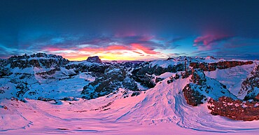 Pink sunset on the snowcapped Gran Cir, Odle, Sassolungo and Sella Group mountains in winter, Dolomites, South Tyrol, Italy, Europe
