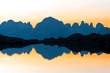 Brenta Dolomites mountains reflected in pristine water of Lago Nero di Cornisello at sunrise, Trentino-Alto Adige, Italy, Europe