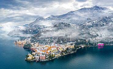 Mist over Varenna old town and Lake Como after a snowfall in winter, aerial view, Lecco province, Lombardy, Italian Lakes, Italy, Europe