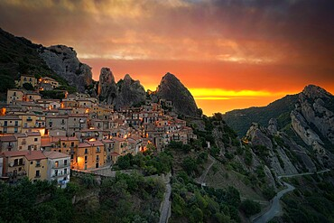 Burning sky at sunrise over the old houses of Castelmezzano and Dolomiti Lucane mountains, Potenza province, Basilicata, Italy, Europe