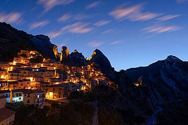 Illuminated village of Castelmezzano framed by Dolomiti Lucane peaks at sunrise, Potenza province, Basilicata, Italy, Europe