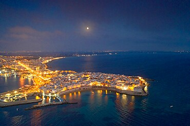 Aerial view of the coastal town of Gallipoli illuminated at night, Lecce province, Salento, Apulia, Italy, Europe