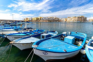 Fishing boats moored in the harbor with old castle and town in background, Gallipoli, Lecce province, Salento, Apulia, Italy, Europe
