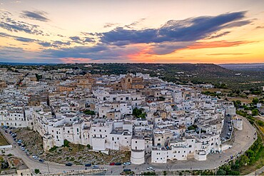 Aerial panoramic of white buildings in the old town of Ostuni at sunset, province of Brindisi, Salento, Apulia, Italy, Europe
