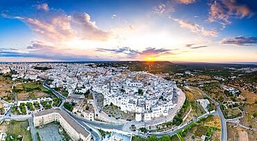 Aerial panoramic of Ostuni at sunset, province of Brindisi, Salento, Apulia, Italy, Europe