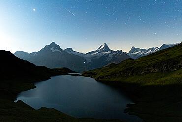 Bachalpsee lake under the starry night sky, Grindelwald, Jungfrau Region, Bernese Oberland, Canton of Bern, Switzerland, Europe