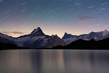 Star trail in the night sky over Bachalpsee lake, Grindelwald, Bernese Oberland, Canton of Bern, Switzerland, Europe