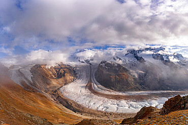 Cloudy sky over snowcapped mountains and Gorner Glacier (Gornergletscher), Zermatt, canton of Valais, Switzerland, Europe