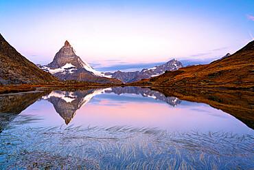 Matterhorn reflected in Riffelsee lake at dawn, Gornergrat, Zermatt, canton of Valais, Switzerland, Europe