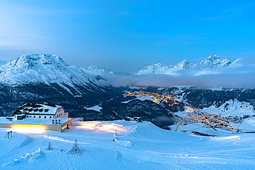 Winter dusk over St. Moritz and Celerina villages covered with snow from Muottas Muragl, Engadine, Graubunden, Switzerland, Europe