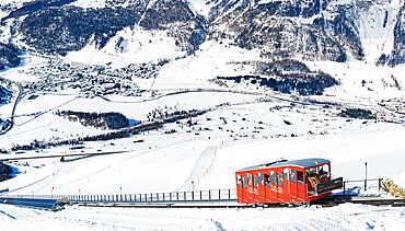 Tourists enjoying the journey on funicular in the snowy landscape, Muottas Muragl, Samedan, Engadine, Graubunden, Switzerland, Europe