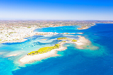 Aerial view of Porto Cesareo coastal town washed by the clear sea, Lecce province, Salento, Apulia, Italy
