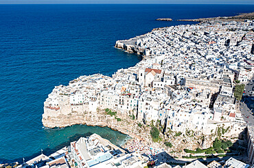 Aerial view of the sea town Polignano a Mare perched on cliffs, province of Bari, Apulia, Italy