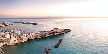 Aerial view of old town and lighthouse of Vieste at dawn, Foggia province, Gargano National Park, Apulia, Italy, Europe