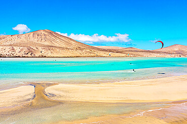 People enjoying kitesurfing at Sotavento beach (Playa de Sotavento de Jandia), Fuerteventura, Canary Islands, Spain