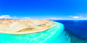 Aerial view of desert landscape of Jandia Nature Park washed by crystal sea, Costa Calma, Fuerteventura, Canary Islands, Spain