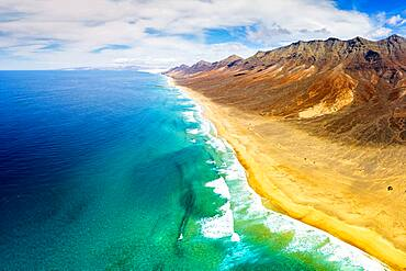Aerial panoramic of mountains and Cofete Beach in Jandia Natural Park, Fuerteventura, Canary Islands, Spain