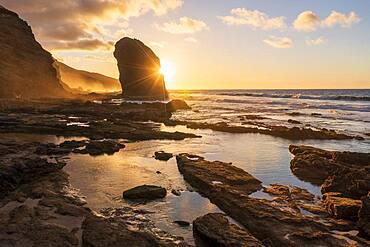 Golden sunset over the giant monolith Roque Del Moro, Cofete beach, Jandia nature park, Fuerteventura, Canary Islands, Spain