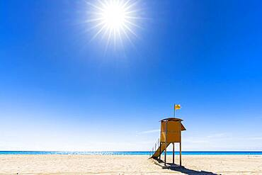 Sun shining over the lifeguard's cabin by the ocean, Morro Jable, Fuerteventura, Canary Islands, Spain, Atlantic, Europe
