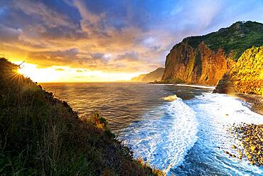 Scenic sky at dawn over waves crashing on cliffs, Madeira island, Portugal, Atlantic, Europe