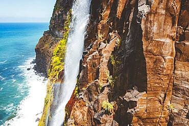 Flowing water of Bridal Veil Fall jumping from rocks, Seixal, Madeira island, Portugal, Atlantic, Europe