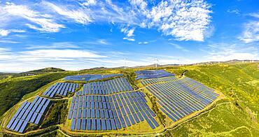 Solar panels and wind turbines on the green plateau, Encumeada, Madeira island, Portugal, Atlantic, Europe