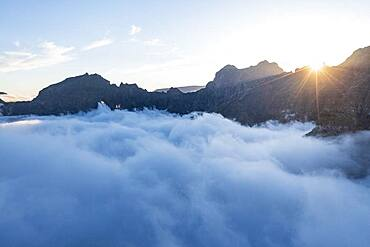 Mountains in a sea of clouds at sunset viewed from Pico Ruivo, Madeira, Portugal, Atlantic, Europe
