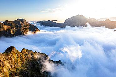 Mountain peaks emerging from clouds at sunset view from Pico Ruivo, Madeira, Portugal, Atlantic, Europe