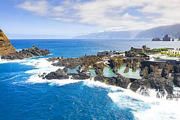 Natural pools formed by volcanic lava filled with crystal-clear sea water, Porto Moniz, Madeira island, Portugal