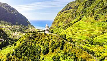 The chapel-tower Nossa Senhora de Fatima on top of green hills, Sao Vicente, Madeira island, Portugal