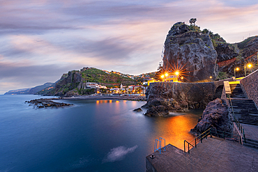 Dusk lights over the seaside town resort of Ponta do Sol washed by the ocean, Madeira island, Portugal