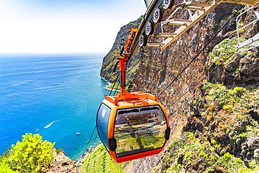 Cable car descending the steep ravine down to the sea, Camara de Lobos, Madeira island, Portugal