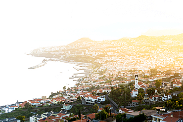 Mist at sunset over Funchal bay and city view from Sao Goncalo, Madeira island, Portugal