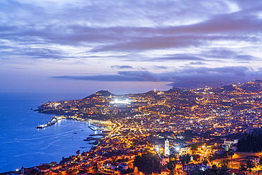Dusk over the iIluminated city of Funchal view from Sao Goncalo, Madeira island, Portugal