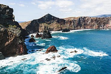 Waves of the Atlantic Ocean crashing on rocky cliffs, Sao Lourenco Peninsula, Canical, Madeira island, Portugal