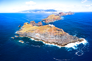 Aerial view of lighthouse on cliffs in the blue Atlantic Ocean, Sao Lourenco Peninsula, Canical, Madeira island, Portugal