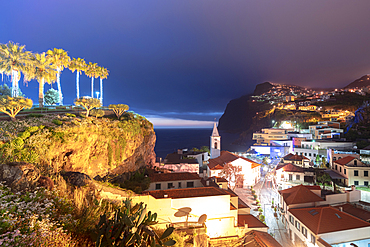 Old town of Camara de Lobos and cliffs at dusk, Madeira island, Portugal