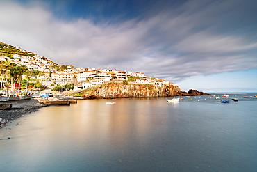Harbor of the white town Camara de Lobos perched on cliffs, Madeira island, Portugal