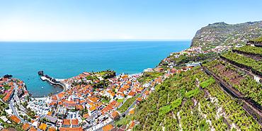 Cultivated terraced fields on hills above the coastal town Camara de Lobos, Madeira island, Portugal