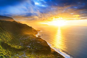 Clouds over Arco de Sao Jorge and Ponta Delgada lit by the warm sunset, Atlantic Ocean, Madeira island, Portugal