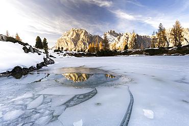 Lagazuoi mount mirrored in the icy lake Limides at dawn, Ampezzo Dolomites, Belluno province, Veneto, Italy