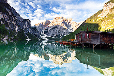 Lake Braies / Pragser Wildsee at sunrise with Croda del Becco mountain reflected in water, Dolomites, South Tyrol, Italy