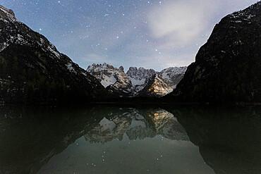 Starry sky over Cristallo group mountains reflected in lake Landro, Dolomites, Bolzano province, South Tyrol, Italy