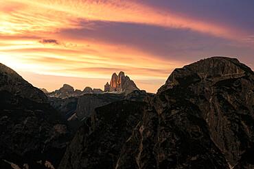 Tre Cime di Lavaredo under the burning sky at sunset, Sesto / Sexten Dolomites, Bolzano province, South Tyrol, Italy